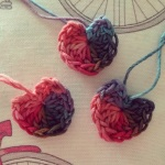 Group of tiny crocheted hearts