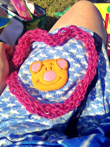 Finger knitting around a Percy Pig biscuit!