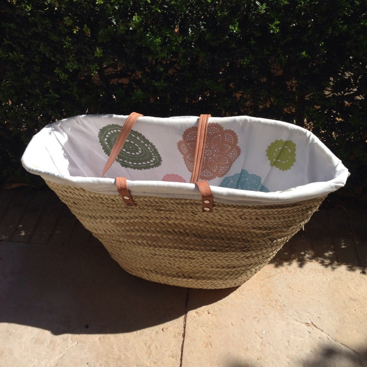 Basket lined with Dottie Angel teatowels